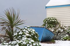 Blue fisherman boat in winter Royalty Free Stock Photo