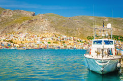 Blue fishermen's boat moored in small port, Greece Stock Photo