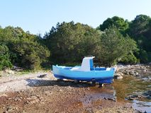 A blue fishing boat in a bay in Croatia Stock Photos