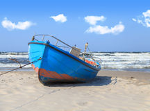 Blue fishing boat on the beach Royalty Free Stock Photography