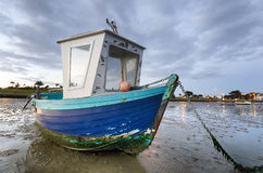 Blue Fishing Boat at Dawn Stock Photography