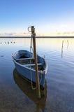 Blue Fishing Boat on the Fleet Lagoon. Blue boat moored at the Fleet lagoon near Weymouth in Dorset Stock Photography