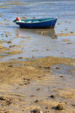 Blue fishing boat at low tide Royalty Free Stock Photography