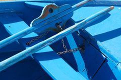 Blue fishing boat with a paddle, Madeira ilsland Portugal. Blue fishing boat with a paddle, Funchail Madeira ilsland Portugal royalty free stock photos