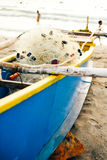Blue fishing boat parked on the beach Stock Image