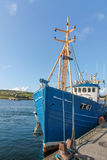 Blue fishing boat in the port Stock Photography