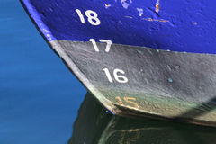 Blue fishing boat reflecting in the water Royalty Free Stock Photos