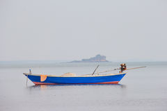 Blue fishing boat on sea Royalty Free Stock Photography