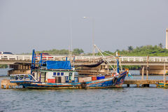 Blue fishing boat on sea Stock Image