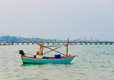 Blue fishing boat on sea Stock Photography