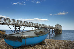Blue Fishing Boat at Selsey Bill Lifeboat Station. Fishing boat at Selsey Bill lifeboat station in West Sussex Stock Photos