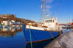 Blue fishing boat with a wooden mast Royalty Free Stock Images