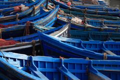Blue fishing boats Stock Photos