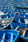 Blue fishing boats aligned in Essaouira Stock Photos