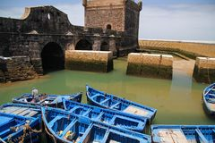 Blue fishing boats on the coast of Essaouira, Morocco stock image