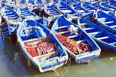 Blue fishing boats in Essaouira, Morocco. Blue fishing boats on an ocean coast in Essaouira, Morocco Royalty Free Stock Photography