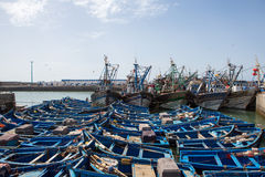 Blue fishing boats in the harbor of Essaouira Stock Photo
