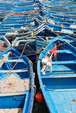 Blue fishing boats in the harbor of Essaouira Royalty Free Stock Photography