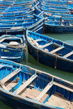 Blue fishing boats in the harbor of Essaouira Stock Photography