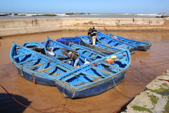 Blue fishing boats in harbour. Blue fishing boats in the port of Essaouira in Morocco Royalty Free Stock Images