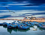 Blue fishing boats on an ocean Royalty Free Stock Photo