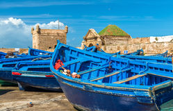 Blue fishing boats in the port of Essaouira, Morocco. Blue fishing boats in the port of Essaouira - Morocco Stock Image