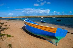 Blue fishing boats in a small cove Morocco Royalty Free Stock Photos