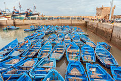 Blue fishing boats in Sqala du Port harbor Royalty Free Stock Image
