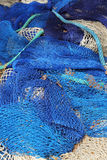 Blue fishing net background Royalty Free Stock Images