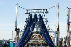 Blue fishing nets or trawl hanging from ship Royalty Free Stock Photography