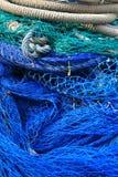 Blue fishing tools, fish net background Royalty Free Stock Image