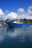 Blue fishing trawlers and other boats, Stock Photos