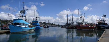Blue fishing trawlers and other boats Royalty Free Stock Images
