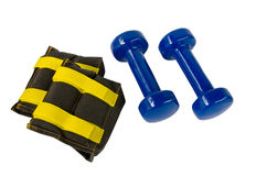 Blue fitness dumbbells and foot weights Stock Photos