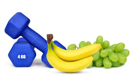 Blue fitness dumbbells with fruits Royalty Free Stock Images