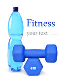 Blue fitness dumbbells and PET bottle with drinking water Stock Photo