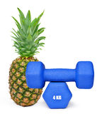 Blue fitness dumbbells with pineapple Stock Photography
