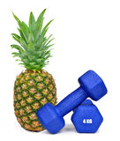 Blue fitness dumbbells with pineapple Stock Photos