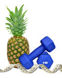 Blue fitness dumbbells with pineapple Royalty Free Stock Image