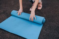 Blue fitness Mat after training at the stadium royalty free stock photos