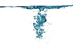 Blue fixxy water  with bubbles over white Stock Photo