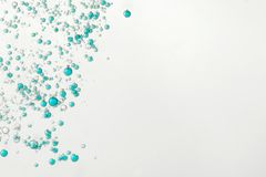 BLue fizz bubbles. Flowing over a light background Stock Image