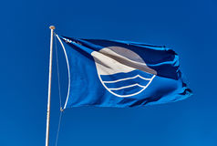 Blue Flag against blue sky royalty free stock images