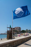 Blue flag on beach Stock Photo