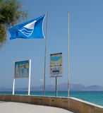 Blue flag beach. CAN PICAFORT, MAJORCA, SPAIN - JULY 12, 2013: Blue flag beach on a sunny summer day on July 12, 2013 in Can Picafort, Mallorca, Balearic islands Stock Photography