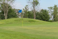 Flag at golf course. Blue flag at golf course Stock Images