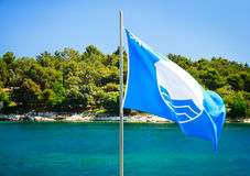 Blue Flag on Summer Sea Background Stock Photography