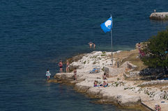 Blue flag of UNESCO. Beach in Croatia, noted by a blue flag of UNESCO for pure water Royalty Free Stock Images