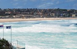 Blue flags and beach arc at Bondi Beach in Sydney. Australia Royalty Free Stock Images