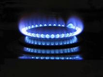 Blue flame. A blue gas flame on a dark background Stock Images